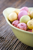 Small easter eggs on a wooden background Stock Photos