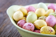 Yellow small easter eggs. On a wooden rustic background Stock Photo