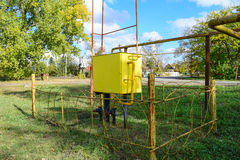 Yellow small gas distribution and regulating natural gas supply station. Royalty Free Stock Photo