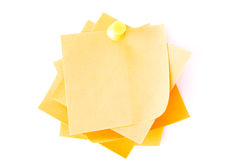Yellow small memo attached with drawin pin. Stock Image