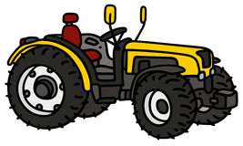 Yellow small tractor Royalty Free Stock Images