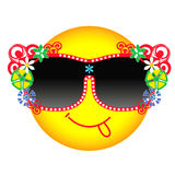 Yellow smile in glasses. Vector yellow smiley face in  fashionable dark glasses decorated with flowers. Round Emoji shows language. Stylish smile in chic glasses Royalty Free Stock Image