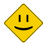 Yellow smile sign. Yellow warning sign of a smile Royalty Free Stock Photo