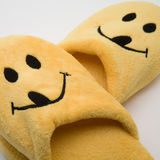 Yellow Smile Slippers. Yellow smiley slippers on a white background stock photography