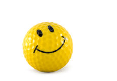 Yellow smiley face golf. Ball on white background stock photo