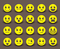 Yellow smiley face icons and emoticons with facial expressions. And emotions in flat paper cut circle. Vector illustration Royalty Free Stock Images
