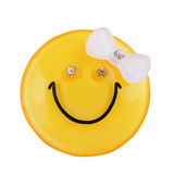 Yellow smiley girl. With a bow and diamonds Royalty Free Stock Photos