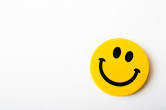 Yellow smiley isolated on the white paper. With empty space Royalty Free Stock Photos