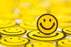 Yellow smiley magnet. Close-up of yellow smiley magnet Stock Photography