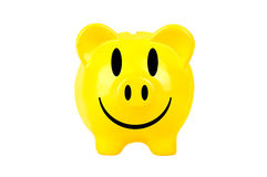 Yellow smiley piggy bank Stock Photography