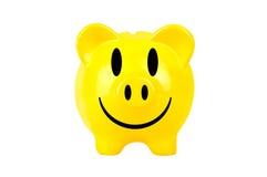 Yellow smiley piggy bank Stock Photography