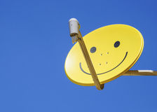 Yellow smiley satellite dish Royalty Free Stock Photography