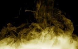 Yellow smoke on the black background Royalty Free Stock Photo