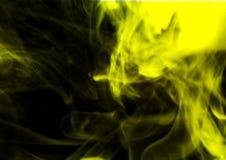 Yellow smoke on a black background. royalty free stock photo