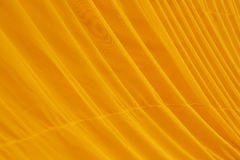 Yellow smooth wave fabric Stock Photography