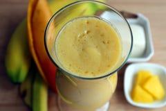 Yellow smoothie made with mango, bananas and pinea Stock Photo