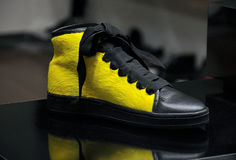 Yellow sneaker Royalty Free Stock Images