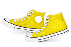 Yellow  sneakers. Pair of  new yellow sneakers  on white background Stock Photography