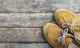 Yellow sneakers from an aerial view on wooden floors. Stock Photos