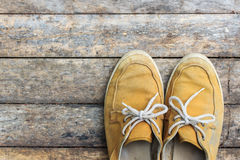Yellow sneakers from an aerial view on wooden. Top view. Royalty Free Stock Photos