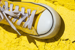 Yellow sneakers. On yellow background Stock Image