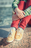 Yellow sneakers on girl legs in hipster style Stock Photos