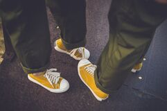Yellow sneakers and green pants