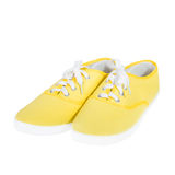 Yellow sneakers isolated on white background Royalty Free Stock Images