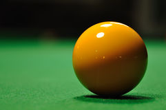 Yellow snooker ball Stock Images