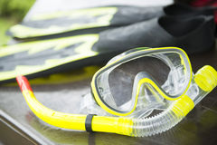 Yellow snorkelling mask and flipper Royalty Free Stock Photos