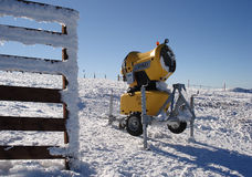 Yellow snow maker on the ski track Royalty Free Stock Images