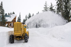 Yellow Snow Plow Clearing Mountain Road Royalty Free Stock Photography