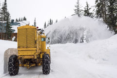 Yellow Snow Plow Clearing Mountain Road Royalty Free Stock Photos
