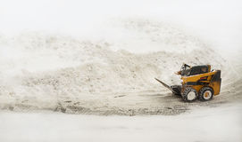 Yellow snow removing bulldozer Stock Photography
