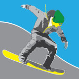 Yellow snowboarder on a slope Stock Photo