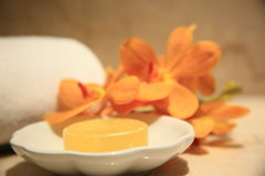 Yellow, soap. Yellwo soap and orchis in a wellness resort Stock Images