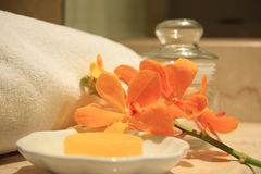 Yellow, soap. Yellow soap and orchids in a wellness resort Royalty Free Stock Image
