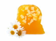 Yellow soap with camomiles Royalty Free Stock Photo