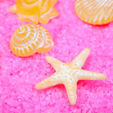 Yellow soaps on pink bath salts Royalty Free Stock Images