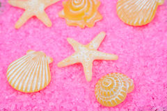 Yellow soaps on pink bath salts Royalty Free Stock Image