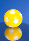 Yellow Soccer Ball with reflection Stock Images