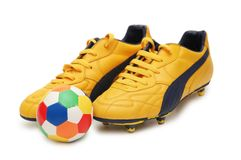 Yellow soccer footwear. And color football isolated on white Stock Photography