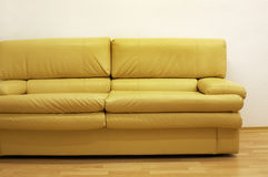 Yellow sofa Royalty Free Stock Image