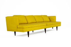 Yellow Sofa. Modern Style Yellow Upholstered Couch isolated on white Royalty Free Stock Images