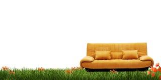 Yellow sofa and green grass stock photos
