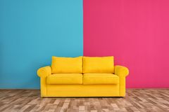 Yellow sofa near color wal. L in room royalty free stock image