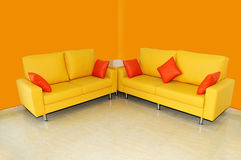 Yellow sofa set with pillows Stock Images