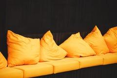Yellow sofa Stock Photos