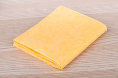 Yellow soft absorbent doormat on table Stock Photos