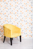 Yellow soft armchair in a room Royalty Free Stock Photos